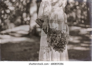 Vintage black and white photo of hand of bride holding flowers