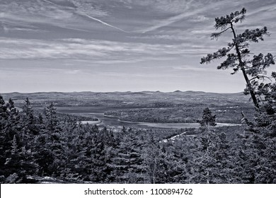 Vintage and black and white view of sky, hills, and trees from Mount Waldo, Frankfort, Maine overlooking the Penobscot River