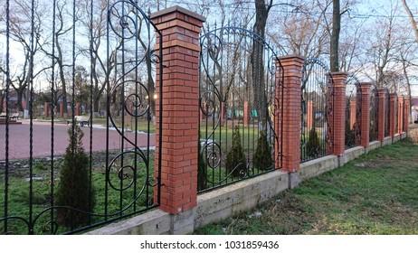 Vintage black wrought metal Fleur de Lis fence closed up