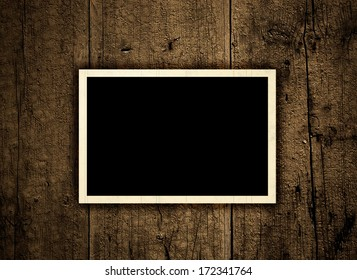 vintage blank photo on the old wooden boards background