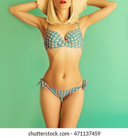 Vintage Blonde in Swimsuit Polka dot on a blue background. Retro Summer Style