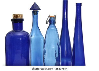 vintage blue bottles collection on isolated background