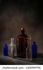 vintage blue and brown poison bottles