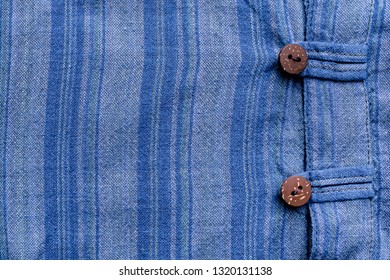 Vintage blue flannel shirt with stripe pattern and wooden buttons with button loops