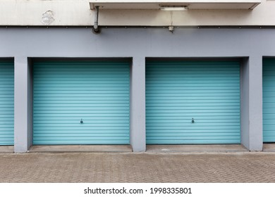 Vintage blue garage doors and a lamp in the Netherlands
