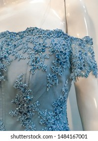 Vintage Blue Gown Dress with Beads Embroidery and Floral Applique on a White Mannequin, shot in a studio