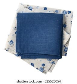 Vintage blue grey flower pattern stack kitchen linen cloth top view.Folded textile towel country style background.