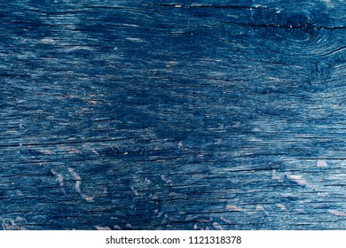 Vintage blue (indigo) wooden texture background. Front view with empty space.