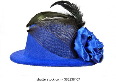 Vintage blue lady's hat with black feathers and textiles decorated,  isolated on white - a carnival costume accessory.