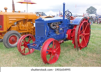 Vintage blue tractor standing in a field