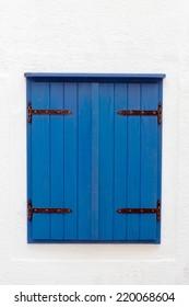 Vintage blue window. Detail of mediterranean house.