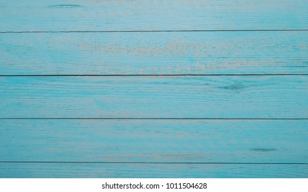 vintage blue wood background texture with knots and nail holes. Old painted wood. Blue abstract background.