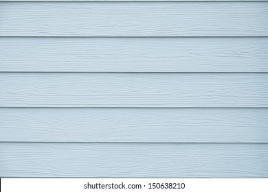 Vintage blue wood texture background of a house wall