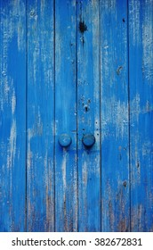 A vintage blue wooden double door in Zanzibar, Tanzania