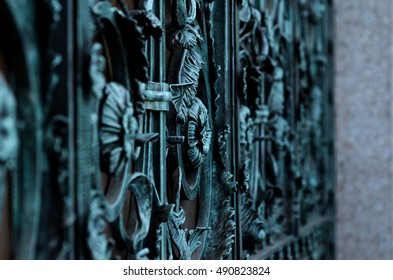 vintage blue wrought iron gate in oxidized patina