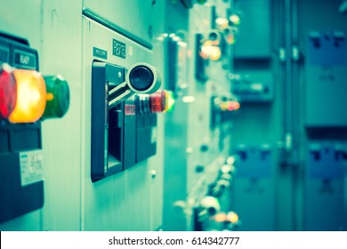 Vintage and blur tone of Electrical switchgear room,Industrial electrical switch panel on plant  and process control with grainy style.
