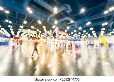 Vintage blurred people at sport event in conventional hall, expo fair to pickup running t-shirt. Wide view bohek crowd of people 5K, 10K, half, full marathon race preparation in Houston, Texas, USA