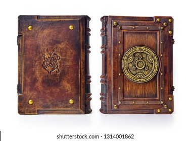 Vintage book captured in standing position.  The transmutation circle symbol, on the font cover is attributed to a German alchemist from the 17th century. Back cover has the Cernunnos ancient symbol.