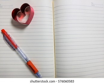 Vintage book pages for your texture, heart shaped and pen.