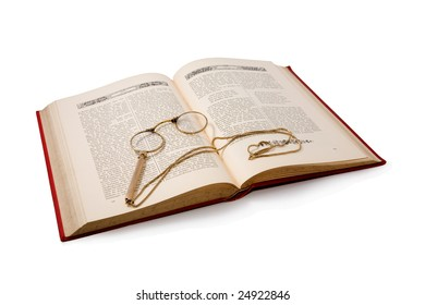 Vintage book and pince-nez. Isolated on white. Path included