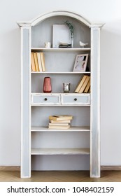 Vintage bookcase cupboard against a white wall background