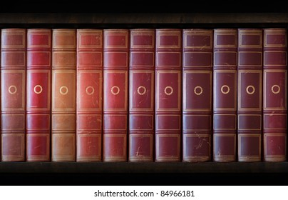 Vintage books in different shades of red and brown in bookcase