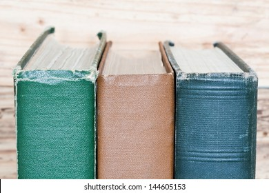 vintage books next to the wooden wall