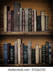 vintage books on wooden shelf.