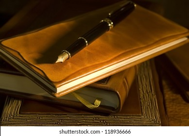 Vintage books and pen (selective focus)