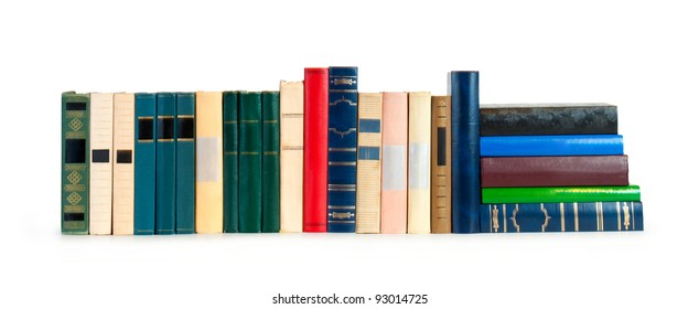 vintage books in a row, isolated on white background, clipping path, empty labels with free copy spac