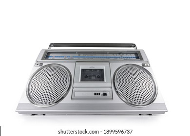 Vintage boombox style FM and short wave radio, stereo cassette tape player and recorder on white.