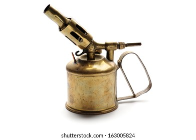 Vintage brass blowtorch isolated at white