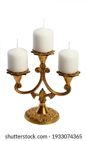 Vintage brass candelabrum for three candles isolated on a white background (with unlit thick candles)