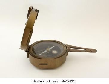 vintage brass compass on white background