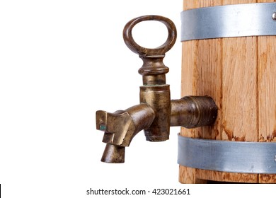 vintage brass faucet in an old oak barrel isolated
