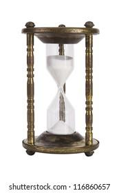 Vintage brass kitchen egg timer isolated over white.