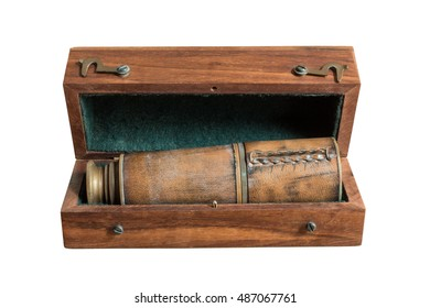 Vintage brass telescope in antique wooden brown caskets box isolated on white