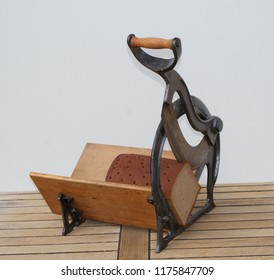 Vintage bread slicer with a country bread