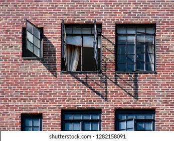 vintage brick facade with opened black muntin windows of an old skyscraper in Manhattan, New York /USA)