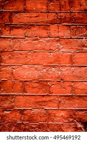 Vintage brick wall with some stones in it, brick wall texture, abstract architecture background, light brick wall with white lines toned to orange