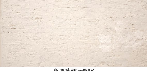 Vintage Brick Wall With White Plaster Horizontal Texture Or Background. Whitewashed Wall In The Room Interior Made Of The Old Clay Painted Bricks. White Stone Wall Urban Background Texture