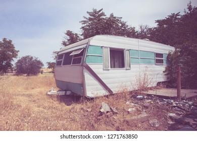 Vintage broken down RV camper trailer with retro toned effect