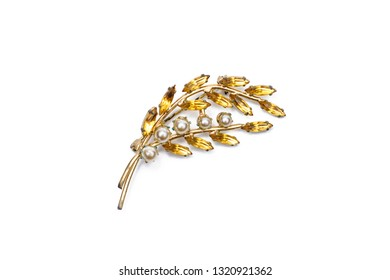 Vintage brooch branch with pearls on a white isolated background