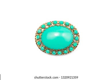 Vintage brooch green with gold on an isolated background