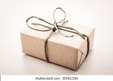 Vintage Brown gift box on wooden background - vintage filter processing