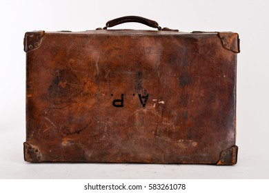 Vintage brown leather suitcase front
