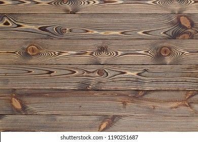 Vintage brown painted rustic old wooden horizontal planks wall textured background. Faded natural wood board panel structure.