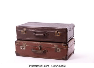 vintage brown suitcases on white background