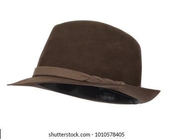 Vintage brown trilby hat isolated on white background.  Almost straight side view. Tilted up a little, showing the interior band.