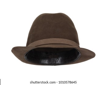 Vintage brown trilby hat isolated on white background.  Almost straight front view. Tilted up a little, showing the interior leather band.